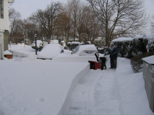 """Man using snowblower to clear 16"""" of snow from driveway"""